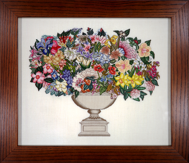Floral design stitched with every DMC color